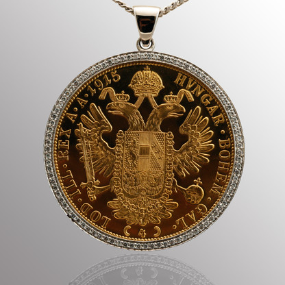 Custom pendant - 14K white gold surrounding an antique coin made of 18K yellow gold and 1/2ct. diamond.  40mm wide.