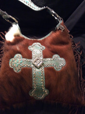 Turquoise cross, brown & white brindle hide.