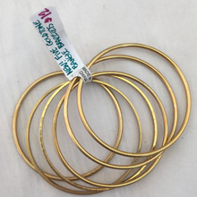 """Differences in color and any """"dimples"""" seen here are due to the differences in texture as listed in the description. Slight oxidation has colored these bracelets, but since they are brand new we did not clean them in our jewelry cleaner!"""