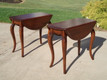 Solid cherry wood with cabriole legs