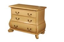 Small Bombay Chest of drawers in a distressed cream finish with swan neck handles.