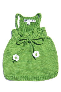 Hand knit sweater dress made of 100% bamboo for year round wear.  Back smocking and adjustable ties make this dress a favorite for dogs of all shapes.  Our knitted dresses give mothers in India the opportunity to stay at home with their children while also remaining in the workforce.  These dedicated women are given special training on how to knit which provides them with the skills needed to produce quality craftsmanship in the comfort of their own homes.  At Dog in the Closet, we feel very fortunate to be able to provide these women this opportunity.