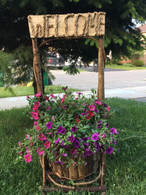 "Barkwood wishing-well planter with welcome sign 32""H"