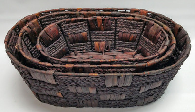 "Largest in a S/3 Oval brown hyacinth & seagrass baskets 17""x11""x6""H"