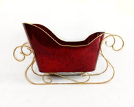 "Metal red sleigh with gold trim 18""x5.25""x7""Hx10.5""H"