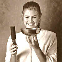 Annette playing an antique Tibetan singing bowl by stricking on it's upper lip