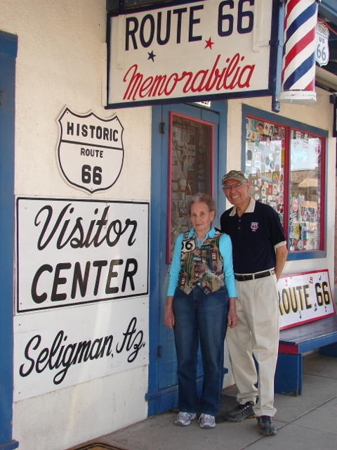 Vilma and Angel Delgadillo in front of their barber shop and Route 66 gift shop in Seligman Arizona