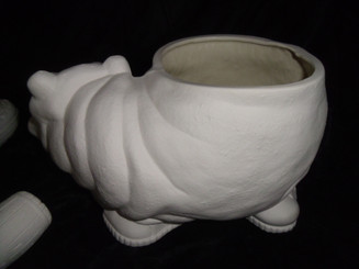 Hippo planter wearing tennis shoes, bisque glazed inside