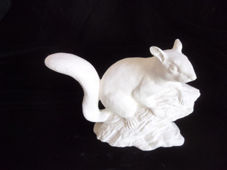 squirrel on stump ready to paint ceramic bisque   appx 9x7