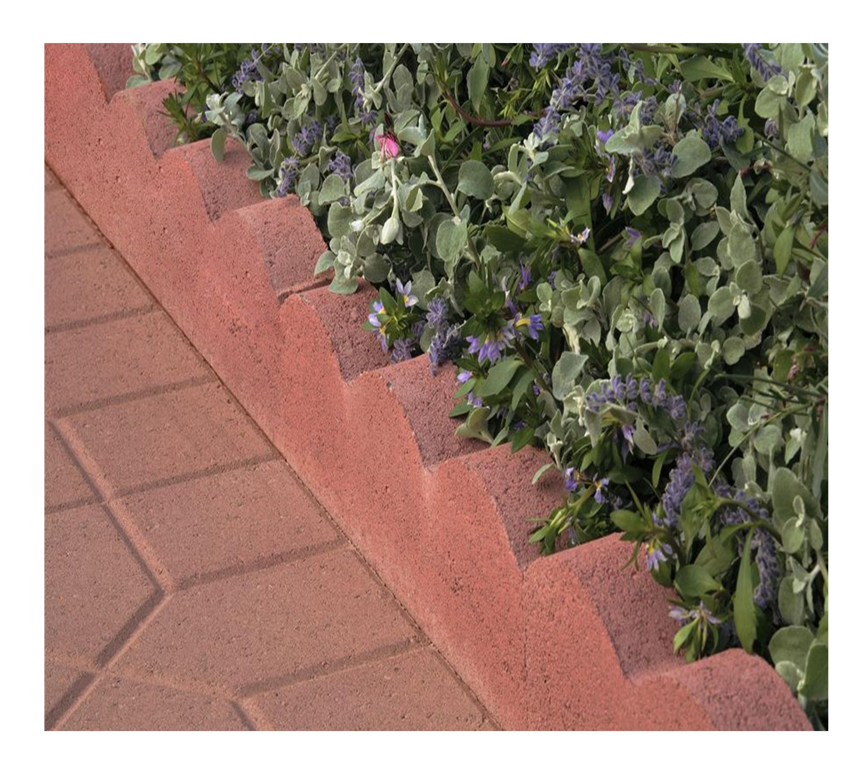 air-vol-24-inch-red-cement-scallop-garden-edging-gc001016-2.29-shown-in-a-landscape.jpg