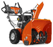 Husqvarna ST 230P has been developed for homeowners who need a high-performing snow thrower to clear snow from large garage driveways and paths. It works regardless of surface type thanks to the adjustable skid shoes. Husqvarna ST 230P has been designed for occasional use in all snow conditions, 10-30 cm. It has an efficient two-stage system with high throwing capacity. The handle has adjustable height for comfortable use. Friction-disc transmission, power steering and extra large tires ensure smooth operation. Features heated handle grips, LED headlights and electric starter for work in all weather conditions.