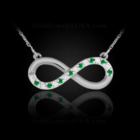 White Gold Infinity necklace with diamonds and emeralds
