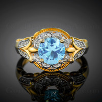 14K two-tone yellow gold genuine Aquamarine solitaire gemstone engagement ring, studded with 20 diamonds.
