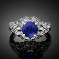 White gold blue sapphire diamond engagement ring.