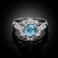 White Gold Aquamarine Gemstone Engagement Ring with Diamond Setting.