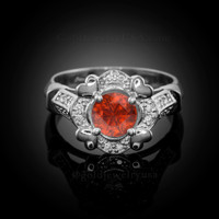 White Gold Red Garnet Gemstone Engagement Ring with Diamond Setting.