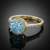 14k Aquamarine solitaire engagement ring with diamond accents.
