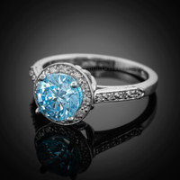 White gold aquamarine engagement ring with diamond accents.