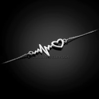 White gold heartbeat bracelet.