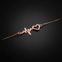 Rose gold heartbeat bracelet.