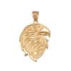 Gold eagle head pendant