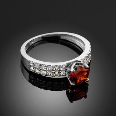 Ladies Diamond pave white gold Engagement/Anniversary ring with Garnet center stone.