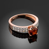 Ladies Diamond pave rose gold Engagement/Anniversary ring with Garnet center stone.