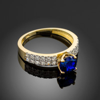Ladies Diamond pave gold Engagement-Anniversary ring with Blue Sapphire center stone.