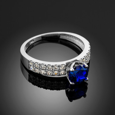 Ladies Diamond pave white gold Engagement/Anniversary ring with Blue Sapphire center stone.
