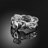 White gold ladies classic claddagh ring with trinity band.