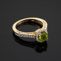 Gold Peridot center stone diamond engagement ring.