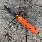 Microtech UTX-85 Orange frame, D/E black blade, black hardware