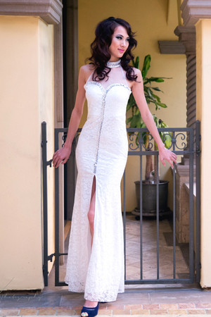 White bejeweled collar and front zipper illusion gown by Atina Collection