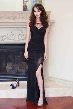 Black lady lithe beaded illusion gown by Atina Collection