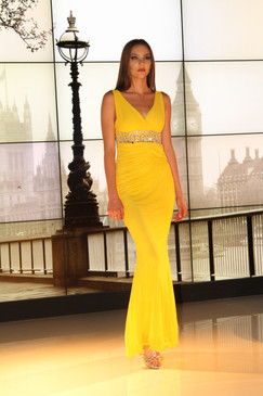 Yellow Gown with beaded waist and Criss Cross back