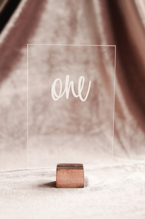 Acrylic hand lettered table numbers by Paper Sushi.