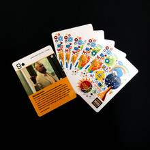 Front of one card with others fanned out showing the back side