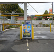 "Bollards and Sleeve's 4"" Clearance Bars and Bollard Covers at a Car Wash drive-thru"