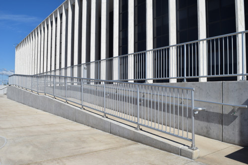 Incline handicap accessible entrance with Aluminum Handrail will infill pickets
