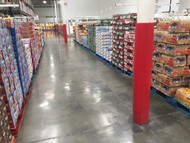 Red Round Column Wrap down an aisle in a big box grocery store
