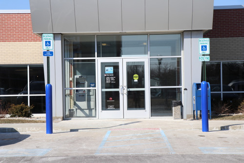 Blue Heavy Duty Sign Bollards lining a bank storefront