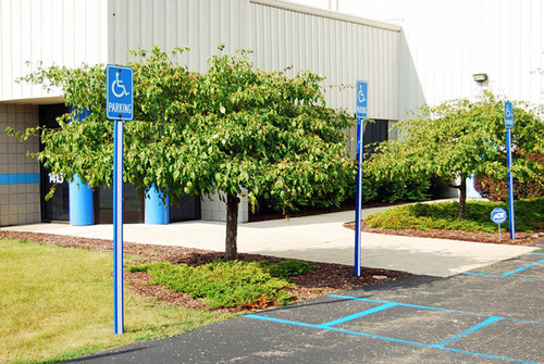 Blue U-Channel Post Covers on Handicap Accessible Parking Posts