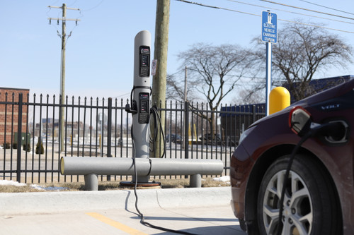 Electric Vehicle Charging Station with one-line guardrail for protection