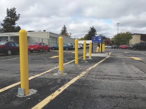 Removable Locking Bollards lining a parking lot