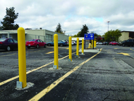 Removable Locking Bollards lining a parking lot