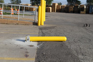 Collapsible Locking Bollard in collapsed position to allow service vehicle entry