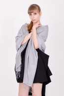 This grey Pashmina is handmade and versatile. It is made in Nepal from the finest cashmere and silk available.