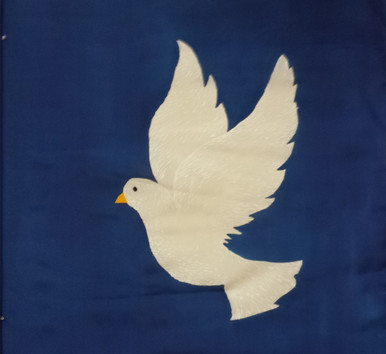 White Dove painted on a hand dyed blue silk background. Both the dove symbol and the color blue are used to represent  PEACE and HOLY SPIRIT.