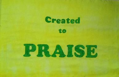 Created to Praise. Bright yellow silk with green letters.