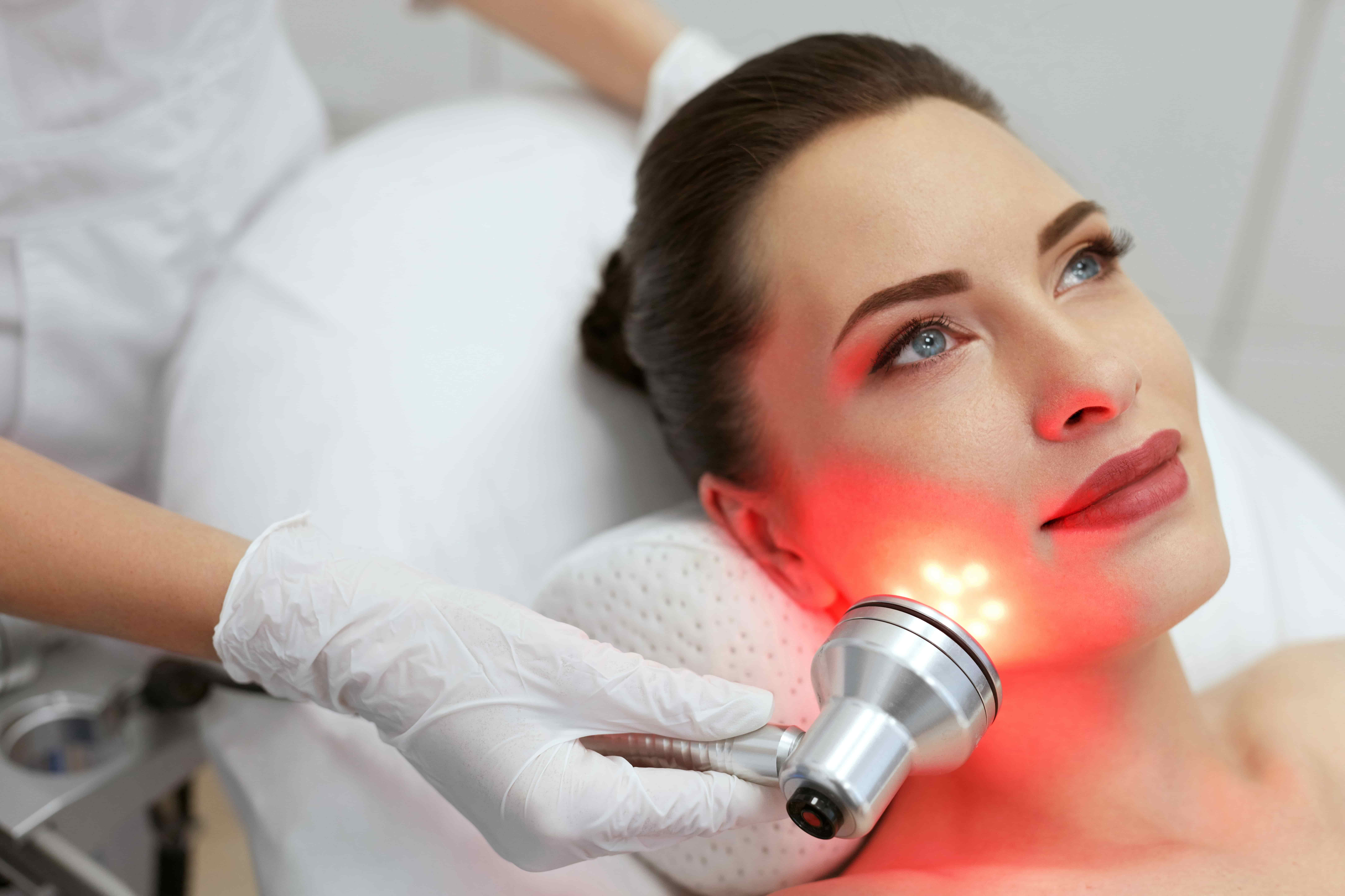 Woman Receiving Red Light Therapy To Her Face